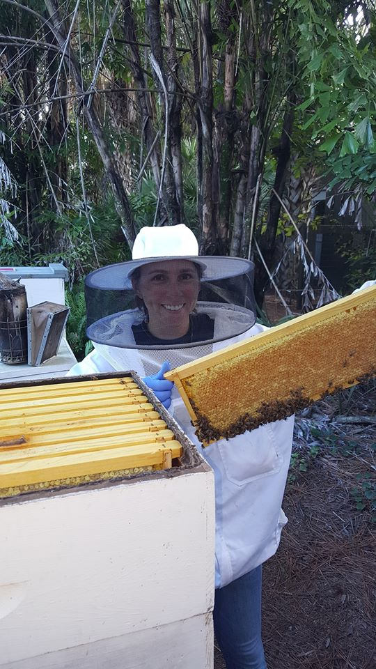 Zoo keepers become Bee keepers after training with BBBK.  After all we are in this together!  P.S. that is an AWESOME frame of capped honey!