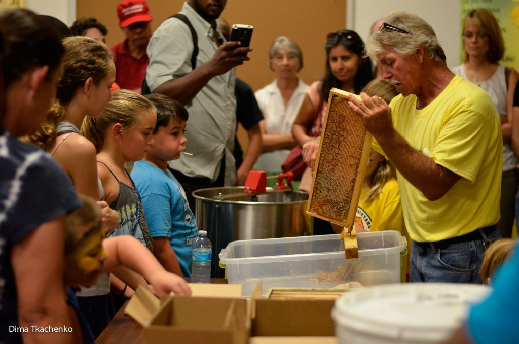 We demonstrate the importance of honeybees to children in the Brevard community.